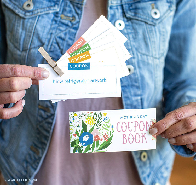 Person holding Mother's Day coupon book and DIY coupons for Mom
