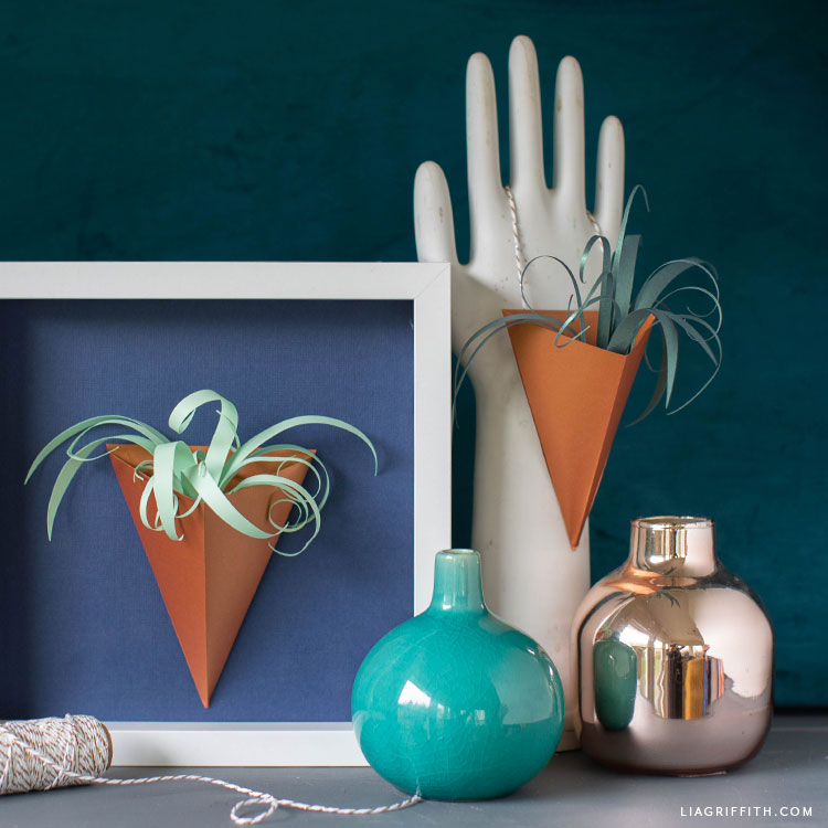 paper air plant vase in frame and paper air plant vase on hand decor