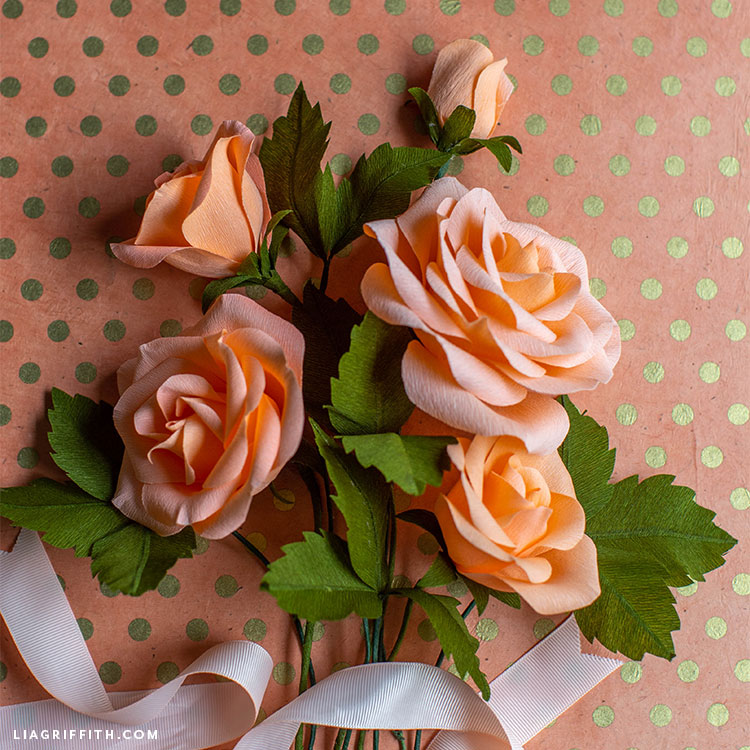 light pink and peach crepe paper roses with leaves