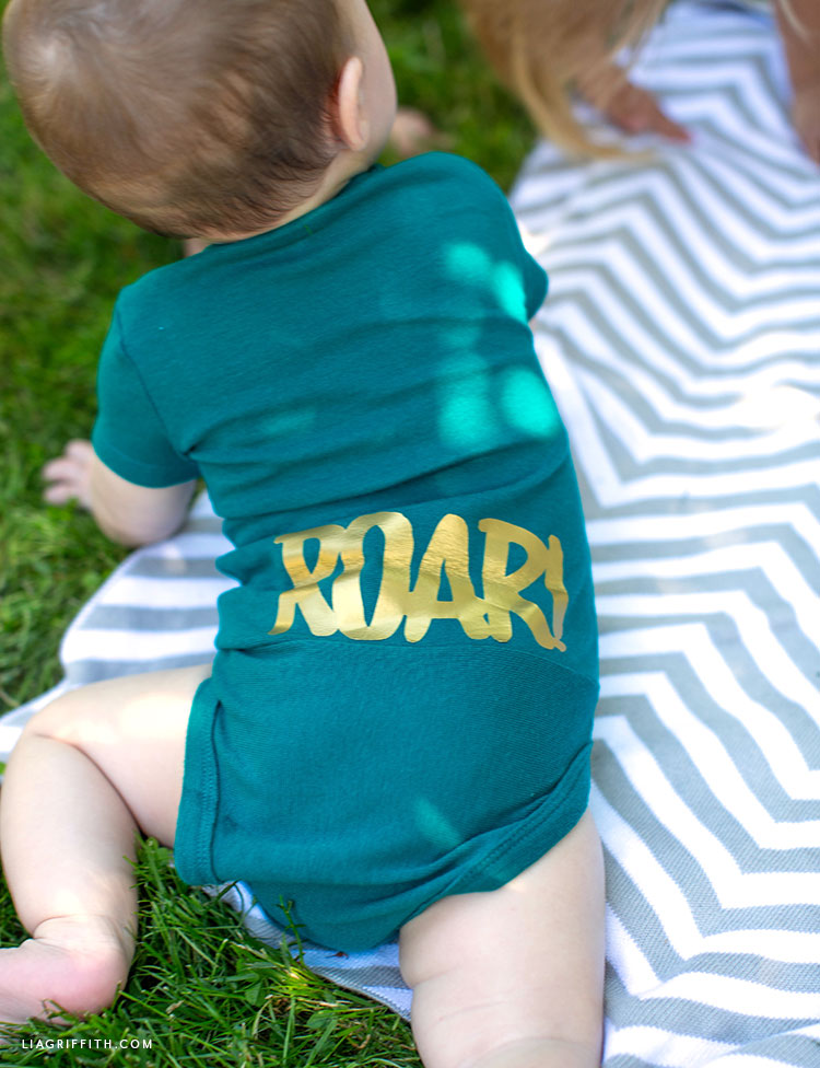 Baby onesie with ROAR on the back