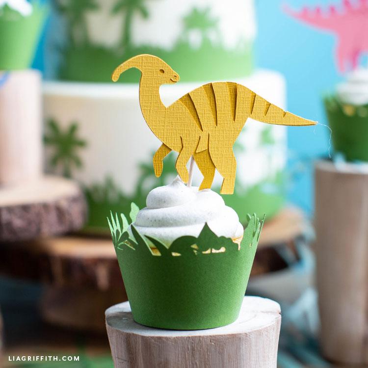 dinosaur cupcake topper in cupcake