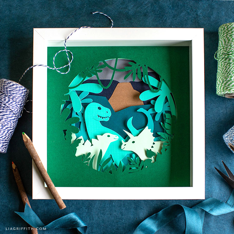 papercut dinosaur artwork in frame