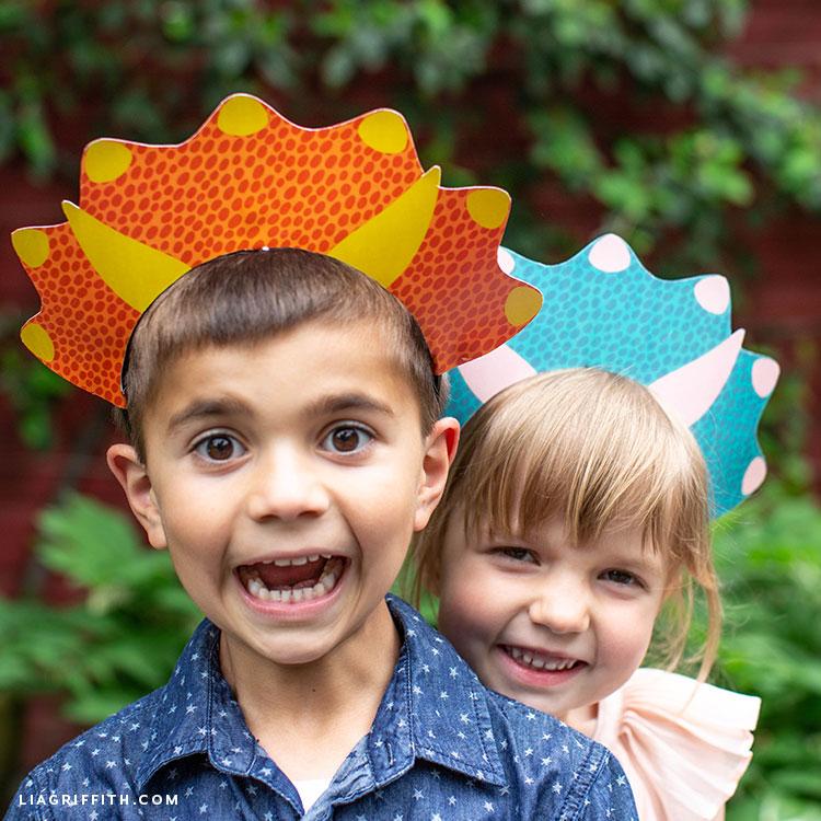 dinosaur headbands on boy and girl outside