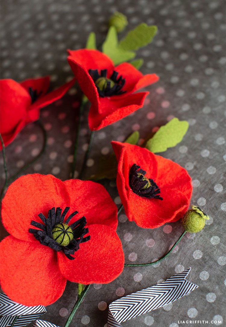 felt red poppies on grey and white polka-dot background