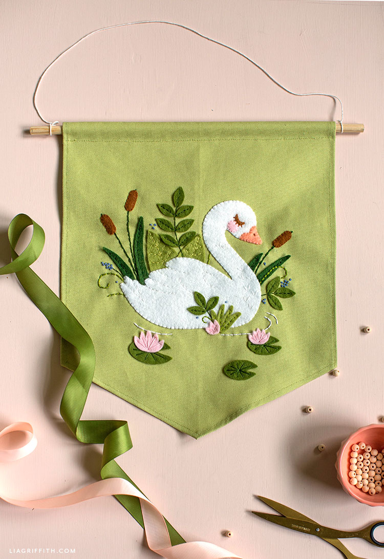 felt applique swan banner with green ribbon