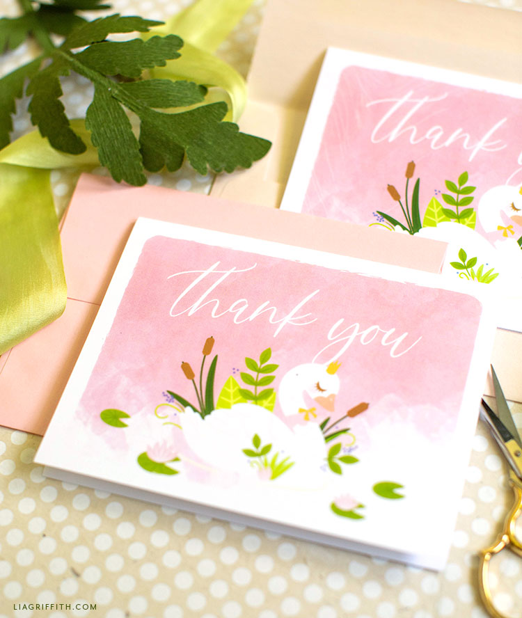 thank-you cards with swan illustration and pink background with pink envelopes