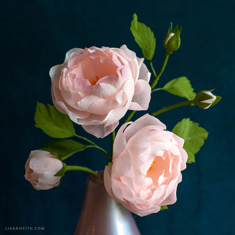 crepe paper heirloom roses in full bloom with smaller buds in vase