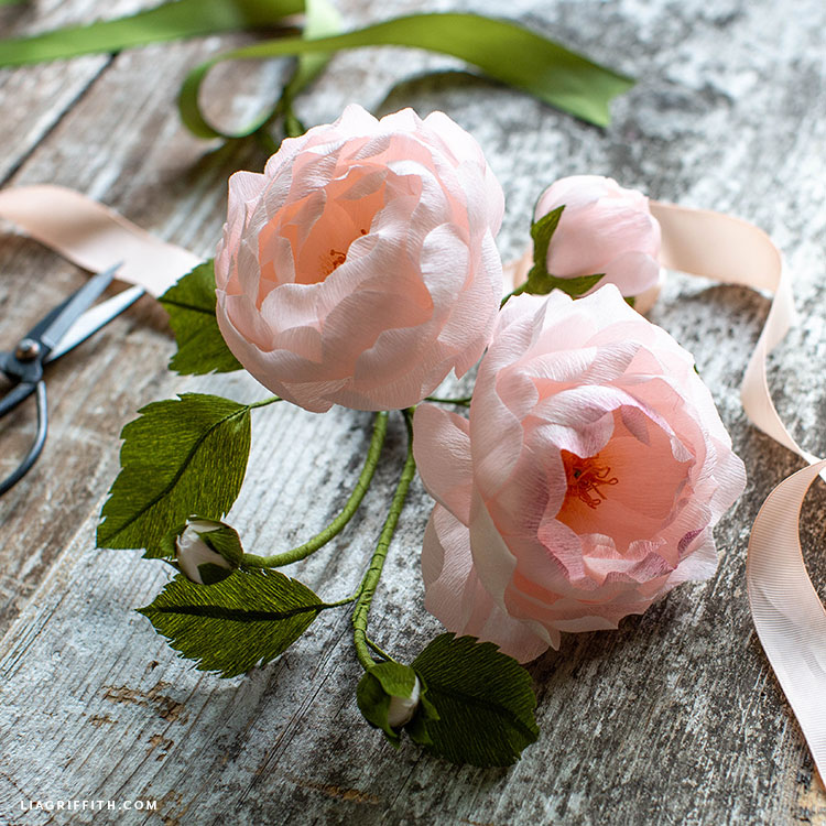 light pink crepe paper heirloom roses with leaves and pink ribbon