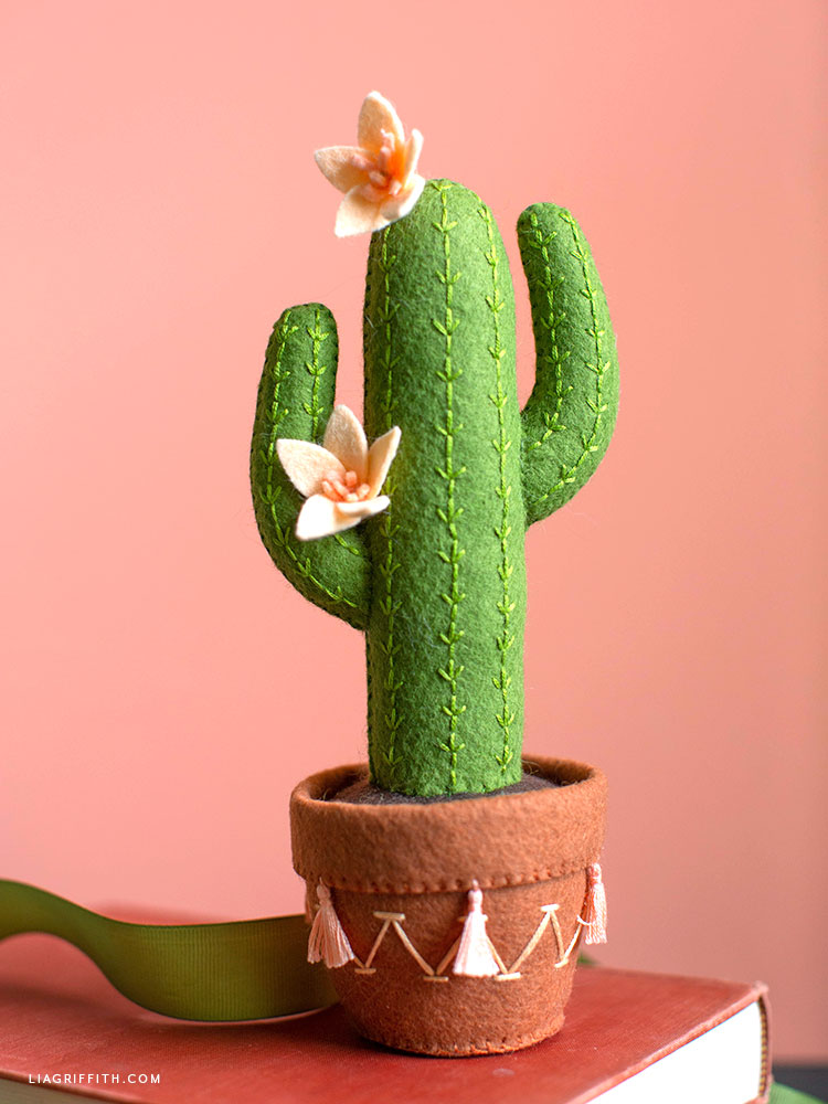 felt saguaro cactus with pink flowers in decorative pot
