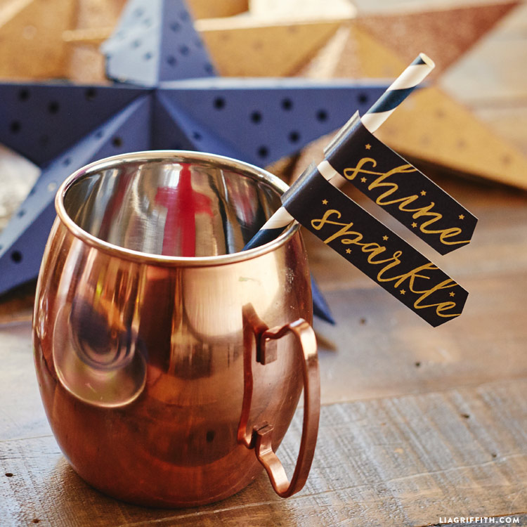 Moscow Mule mugs with paper straw flags and 3D paper stars in background