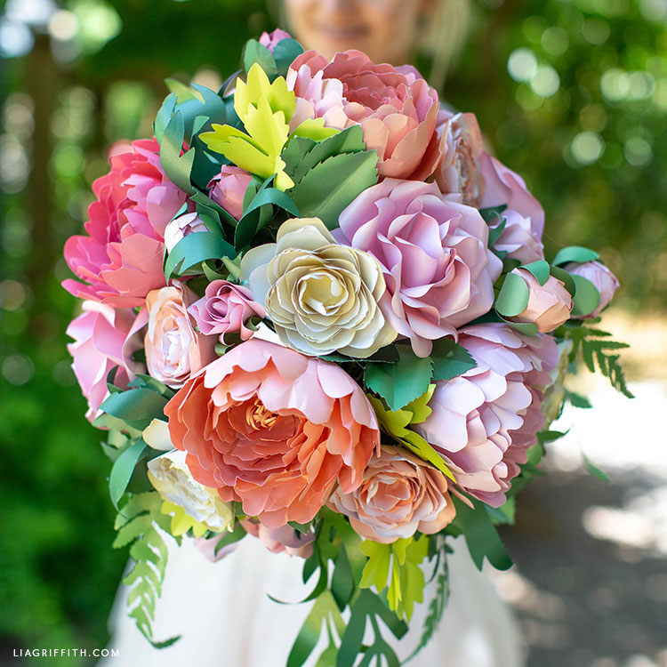 DIY bridal bouquet with frosted paper flowers and greenery