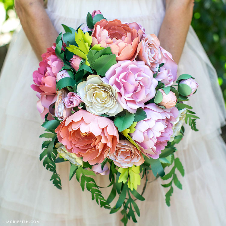 DIY bridal bouquet with paper roses, peonies, ranunculus, and greenery
