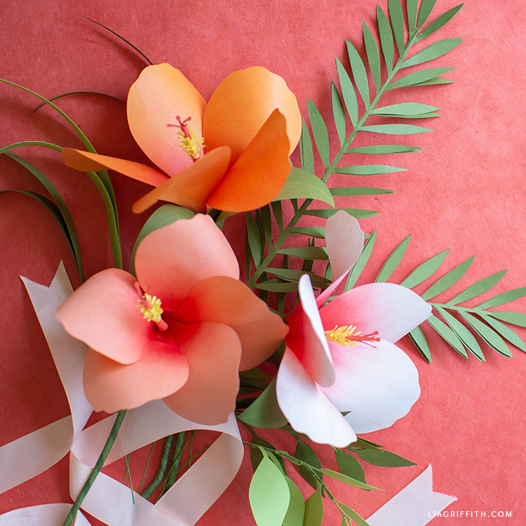 paper hibiscus flowers and paper greenery