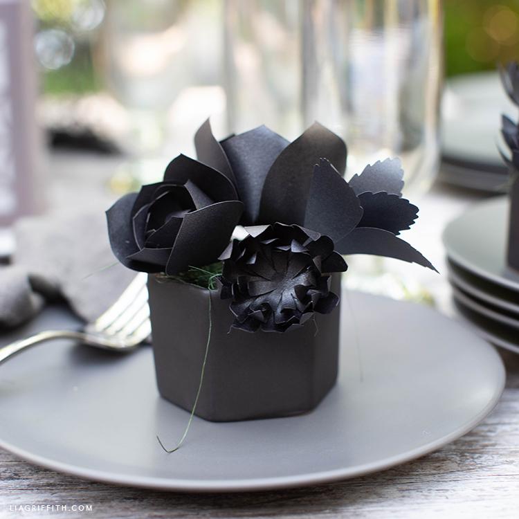 black paper succulents in pot