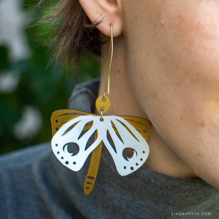 handmade shrink film moth earrings