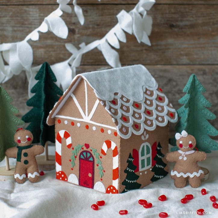 felt gingerbread house with felt gingerbread people, mini felt trees, and felt garland