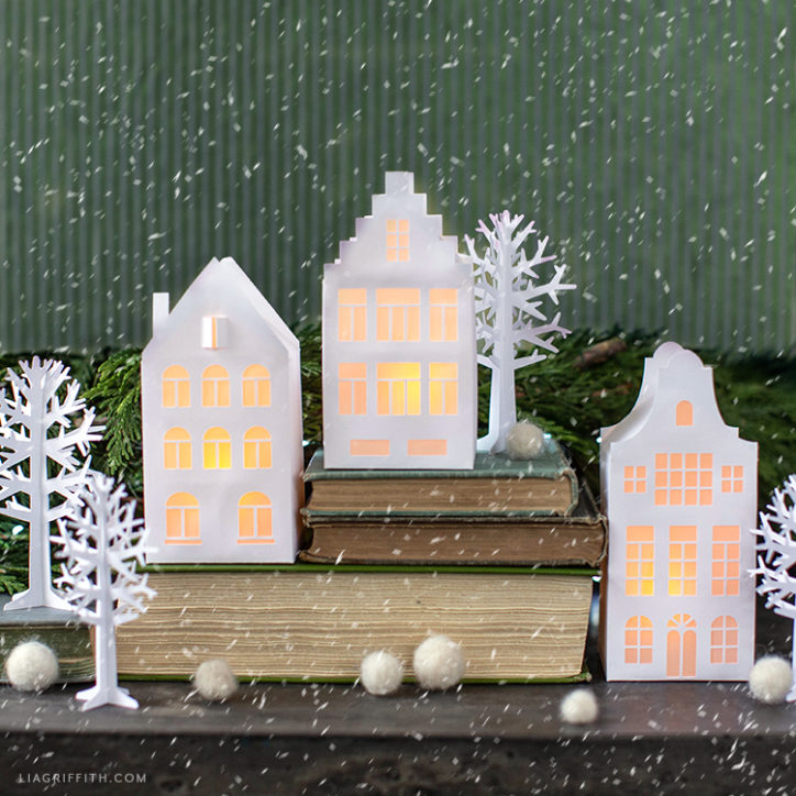 Christmas mantel with papercut European houses and paper trees