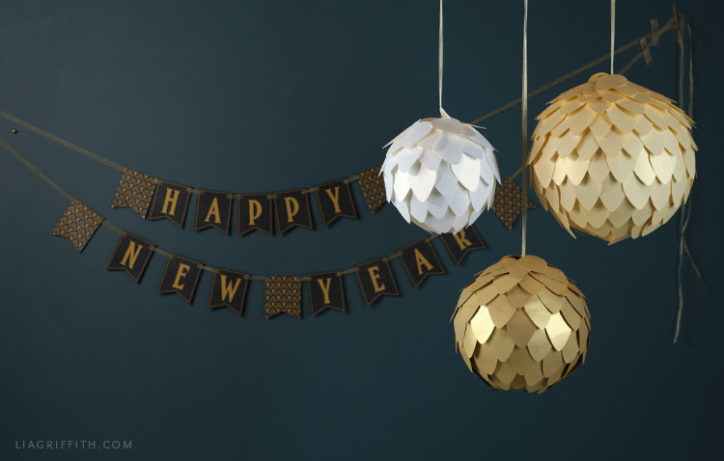 Happy New Year's Eve banner and paper disco balls