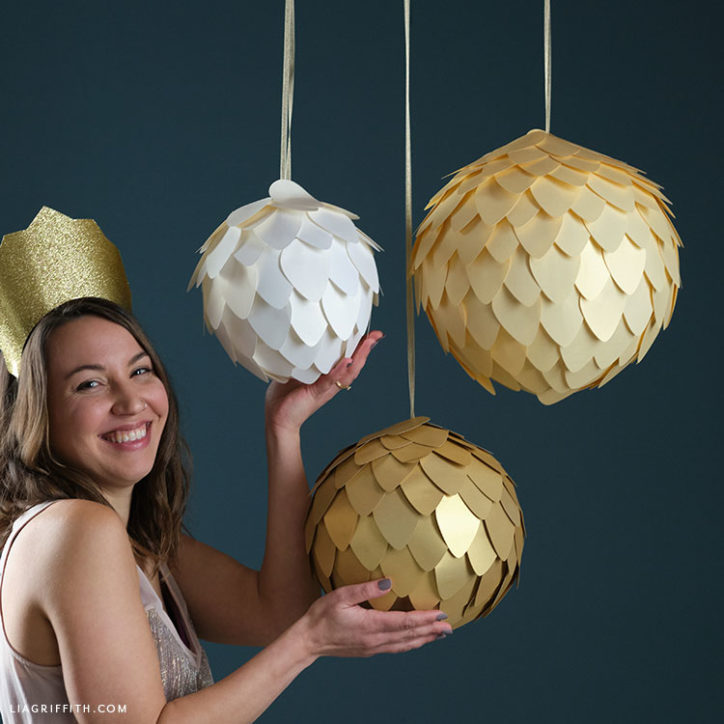 papercut gold crown and frosted paper disco balls