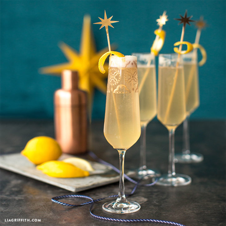 Champagne cocktail and papercut stirrers
