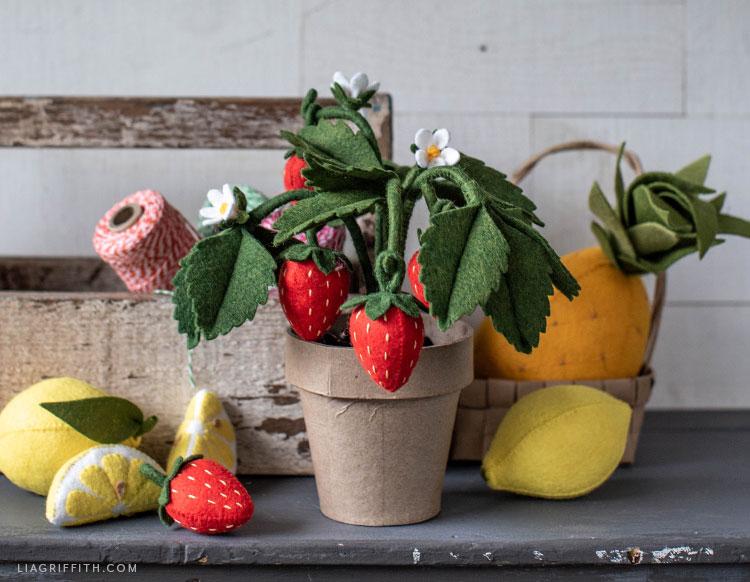 felt strawberry plant with felt lemons and felt pineapple