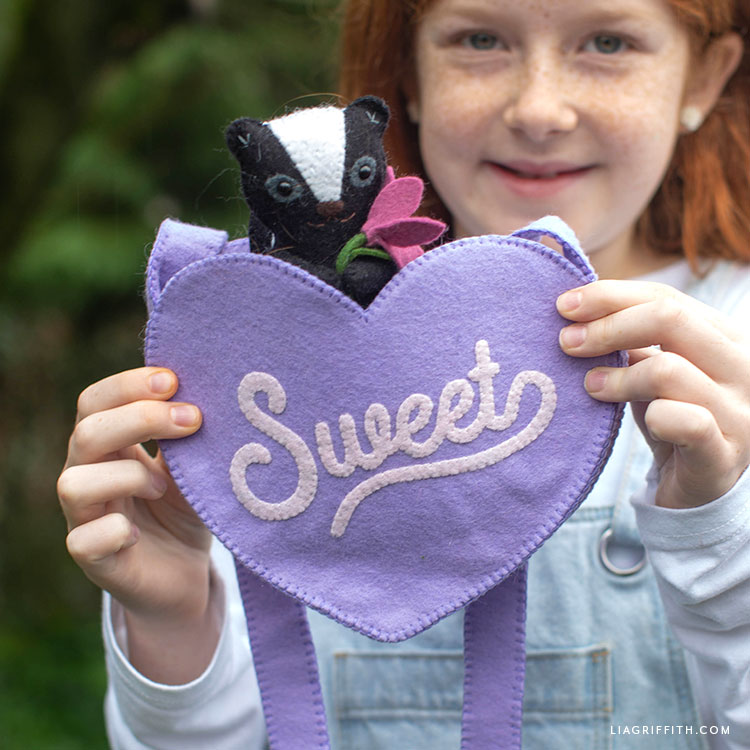 handmade felt heart purse with felt skunk stuffie