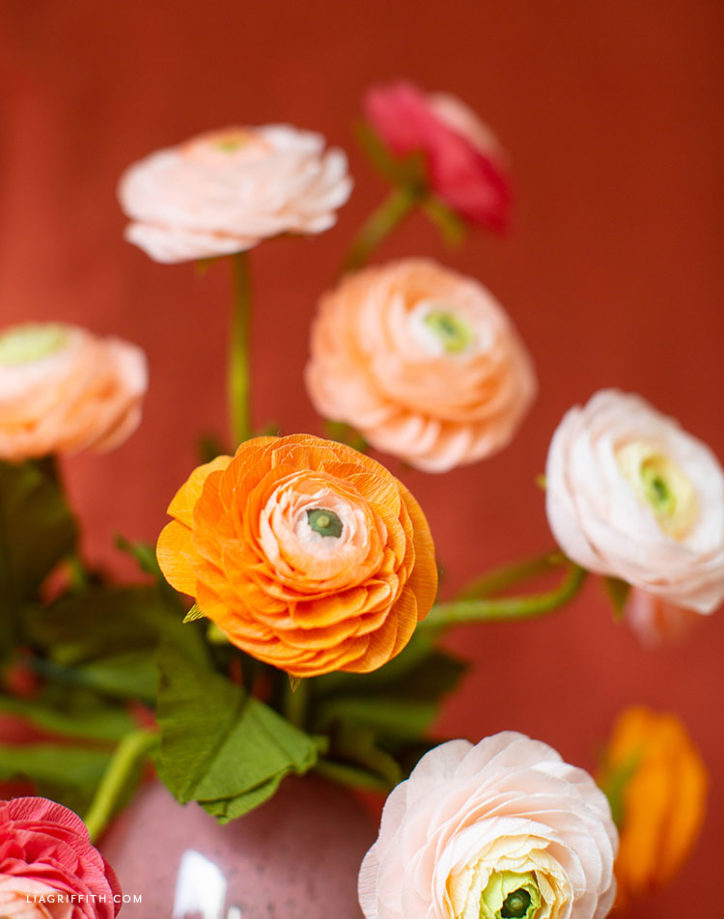 pink and orange crepe paper ranunculus flowers