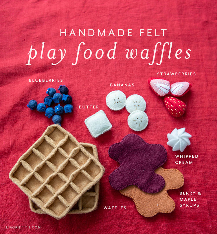 handmade felt play food waffles with felt blueberries, bananas, butter, strawberries, whipped cream, and berry and maple syrups