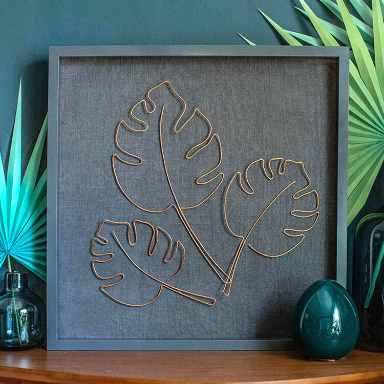 A framed wire leaf set.