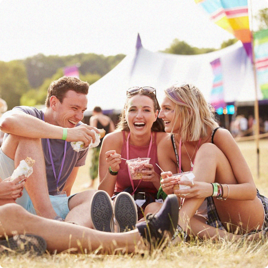 group of young people eating ice cream at a festival