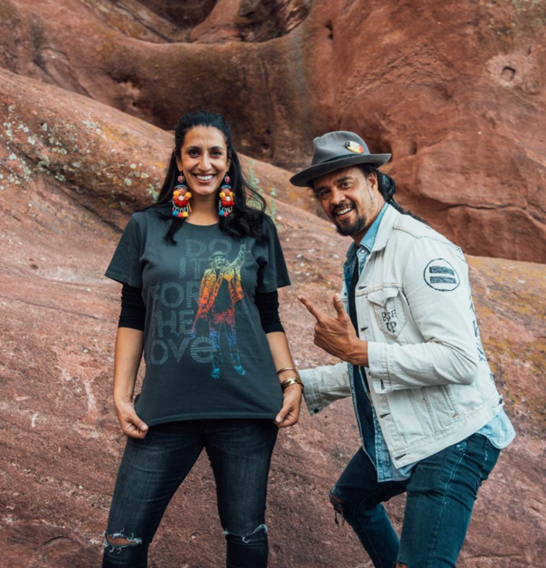 Michael Franti posing with his wife