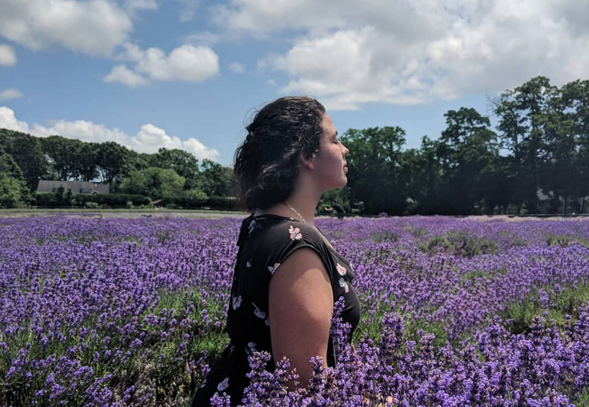 Colette in a field of flowers
