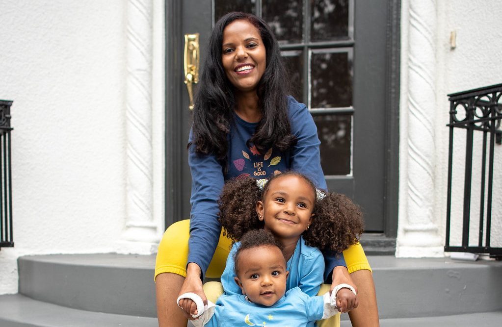 Mom on stairs with children