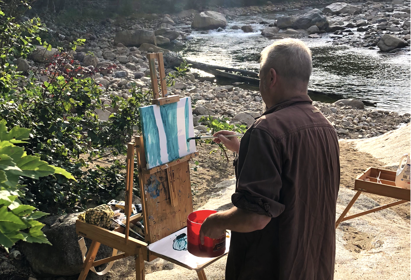 Bill painting near water