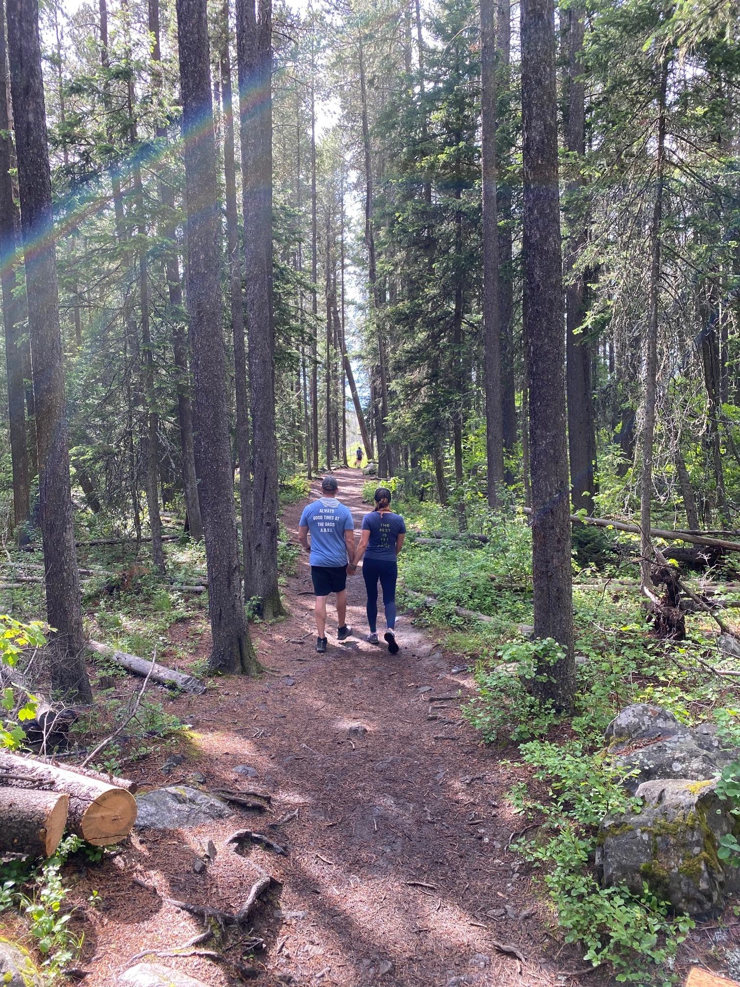 Friends walking in the woods