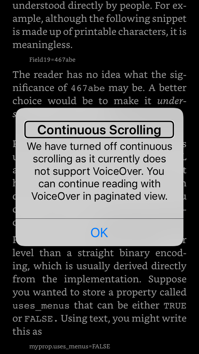 VoiceOver enabled on the Kindle app, with a notification: Continuous Scrolling. We have turned off continuous scrolling as it does not support VoiceOver. You can continue reading with VoiceOver in paginated view.