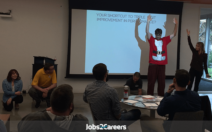 Lisa Cummings facilitating management training on using your strengths and natural talents at Jobs2Careers [image of class interaction]