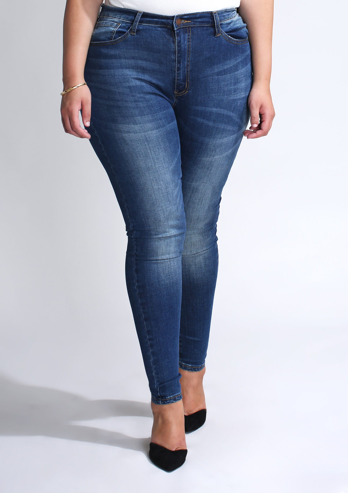 PLUS Solid Mid Rise Skinny Jeans