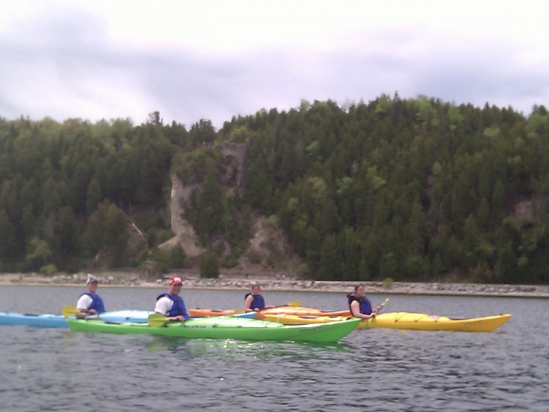 Kayaks on the water in front of Arch Rock
