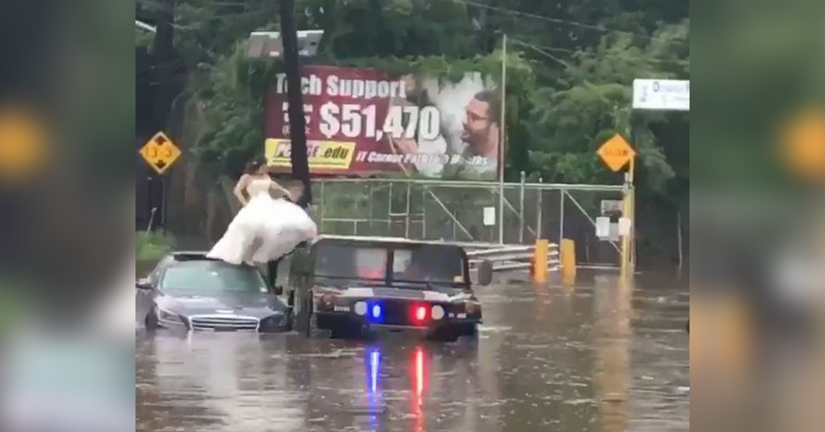 VIDEO: Police Rescue Bride From Flood On Wedding Day