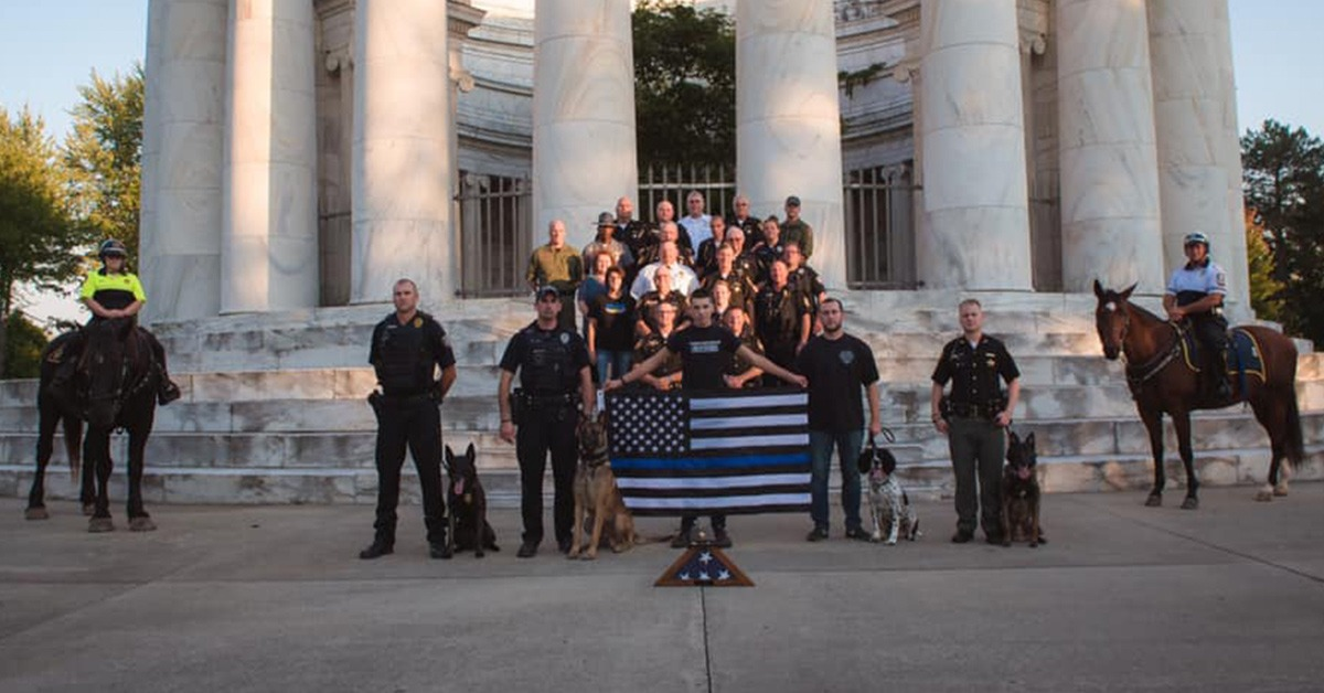 Fallen Officer's Family & Local Officers Chastised For Photo Shoot At Memorial