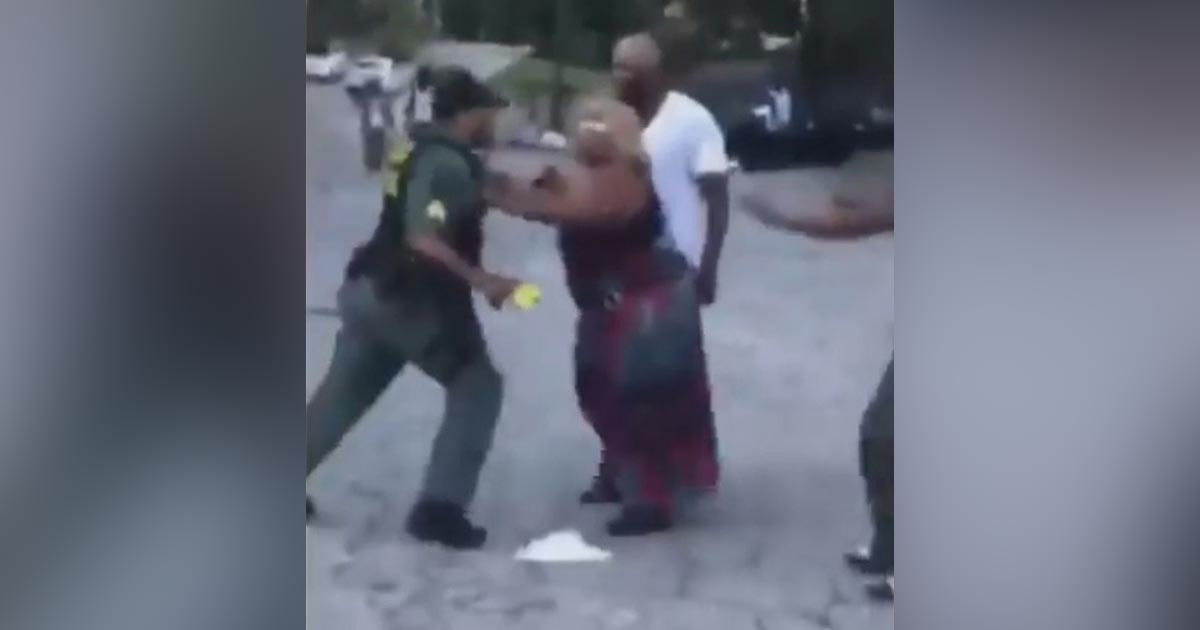 VIDEO: Crowd Fights Cop As He Tries To Make Arrest At Crash Scene