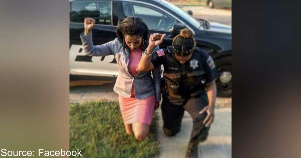 Village Of Phoenix Police Department Responds To Their Officer Kneeling In Photo