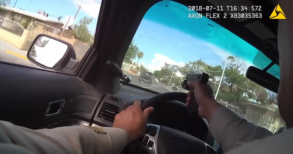 VIDEO: Officer Takes Out Two Gunmen By Shooting Through Window During Pursuit