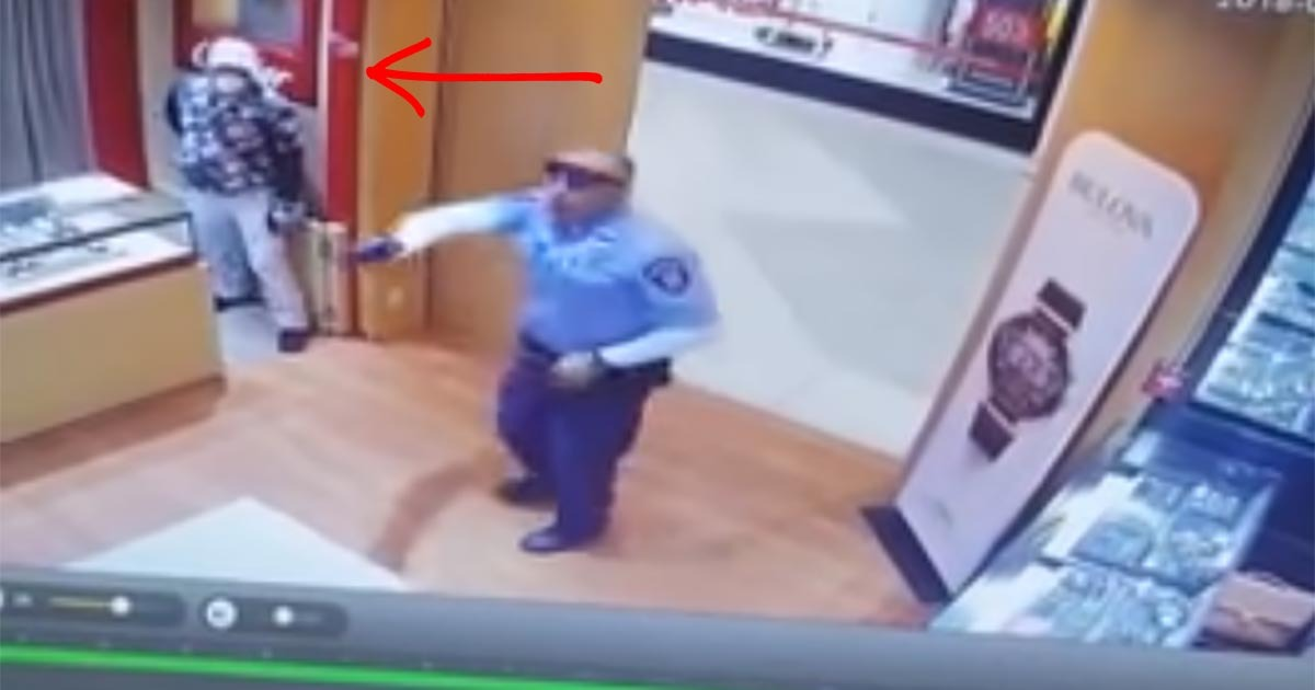 VIDEO: Surveillance Captures Moment Cop Confronts 7 Jewelry Store Robbers