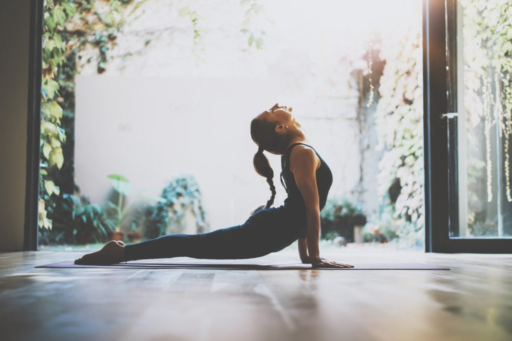 How CBD Oil Can Improve Your Yoga Routine