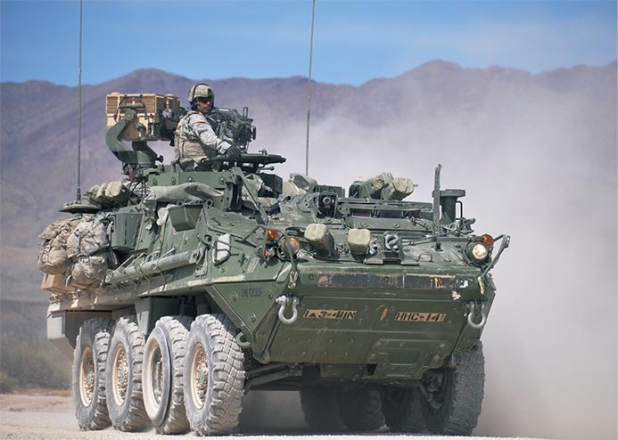 How Bomb-Stopping Strykers, MRAPs & Body Armor Were Delivered Fast to Save Live