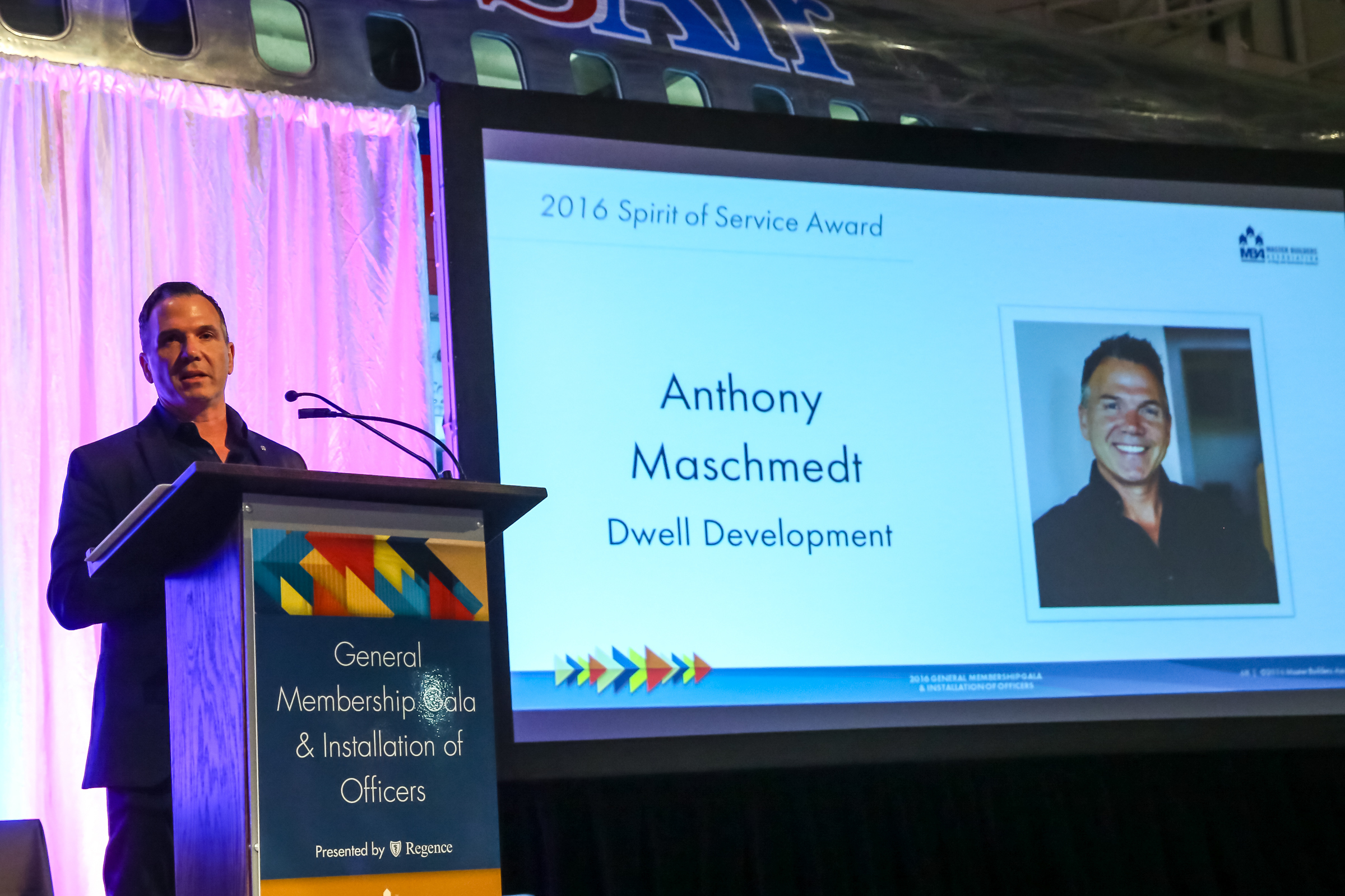Anthony Maschmedt, Dwell Development, accepting the 2016 Built Green Moving the Market Award