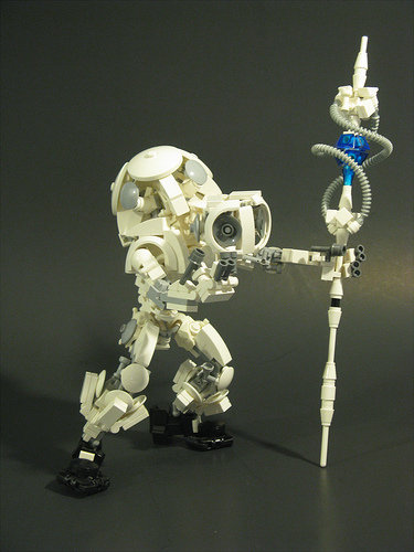 White LEGO mecha with staff