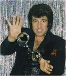 Mario manzini head shot holding handcuffs